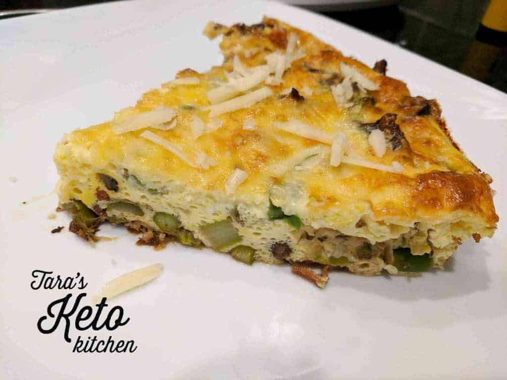 a slice of Keto Breakfast Frittata on a white plate