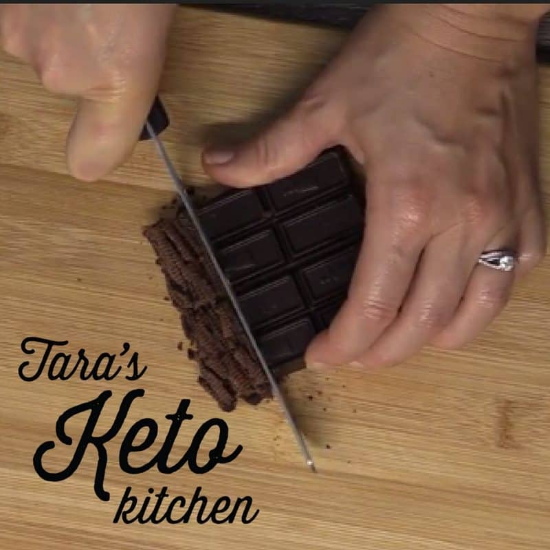 cutting chocolate for these fudgy keto brownies