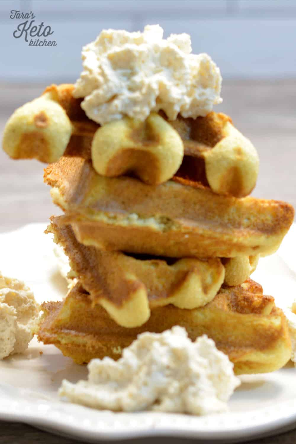 four Belgian keto waffle triangles stacked on top of each other