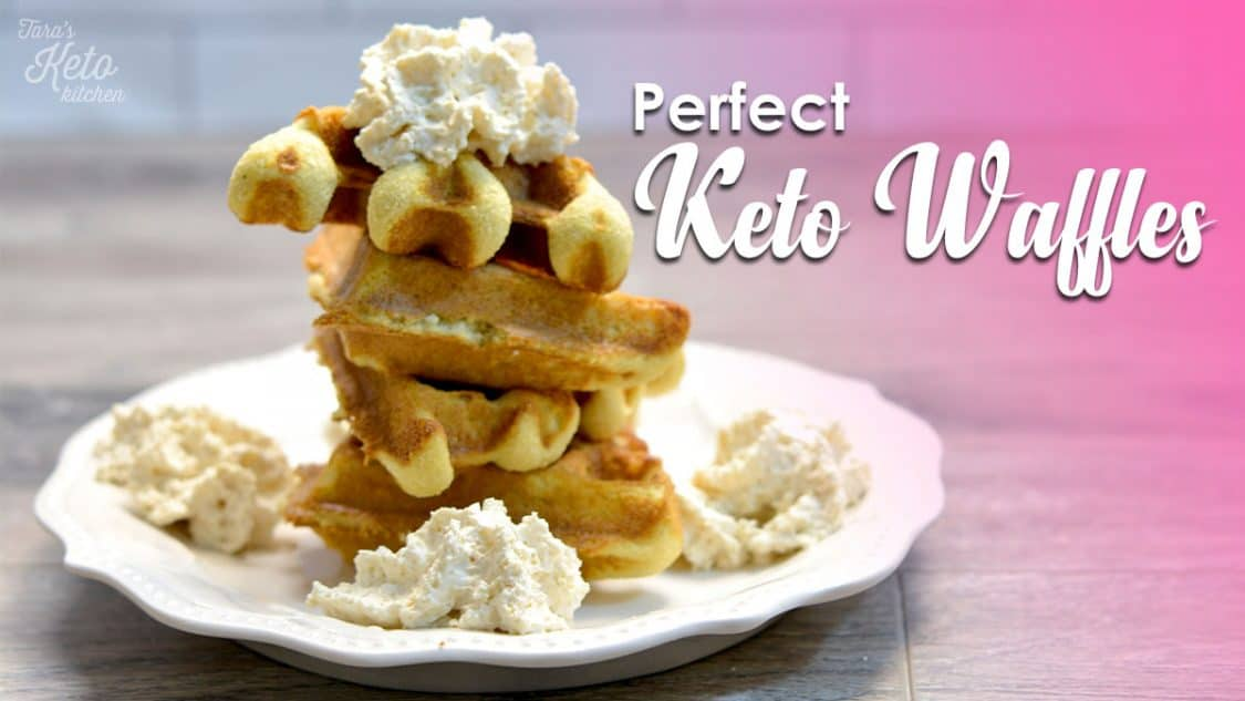 """four waffle wedges on a white plate topped with real whipped cream with text """"Perfect Keto Waffles"""" on image"""