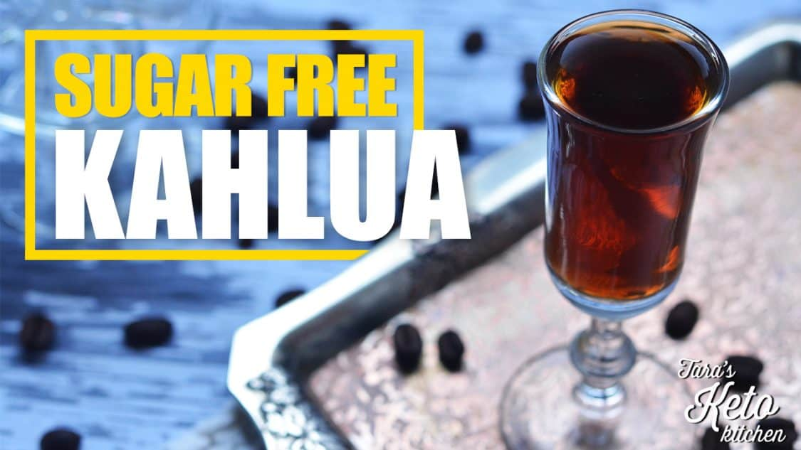 a glass of sugar free kahlua shown on an antique tray