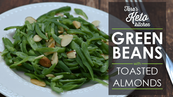 keto green beans with toasted almonds shown in a white bowl