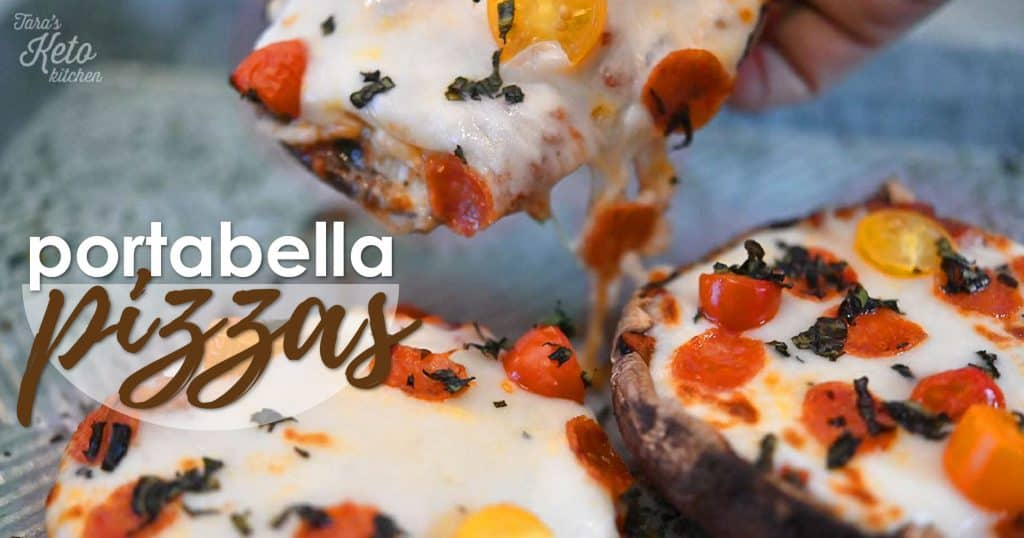 Portabella keto Pizzas shown on a baking pan with melted cheese