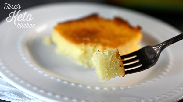 Keto Gooey Butter Cake shown on a white plate with a bite on a fork