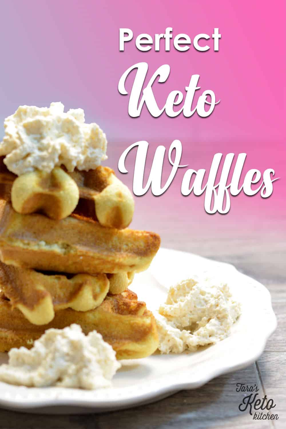four keto waffle triangles stacked on a plate with real whipped cream on top and edges